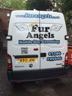 QR Code on the back of a van. Click to visit Fur Angels website